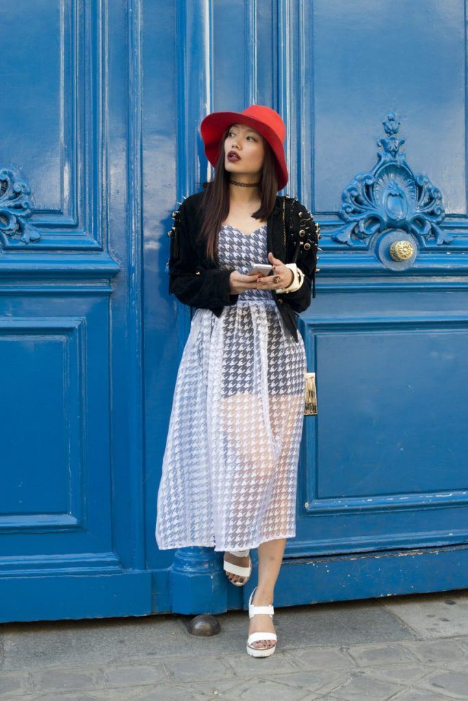 PARIS, FRANCE - OCTOBER 1: Fashion Blogger Thythy Nguyen wears a vintage jacket, Rare London dress, Topshop shoes and hat and a Max London bag on day 3 during Paris Fashion Week Spring/Summer 2016/17 on October 1, 2015 in London, England. (Photo by Kirstin Sinclair/Getty Images)