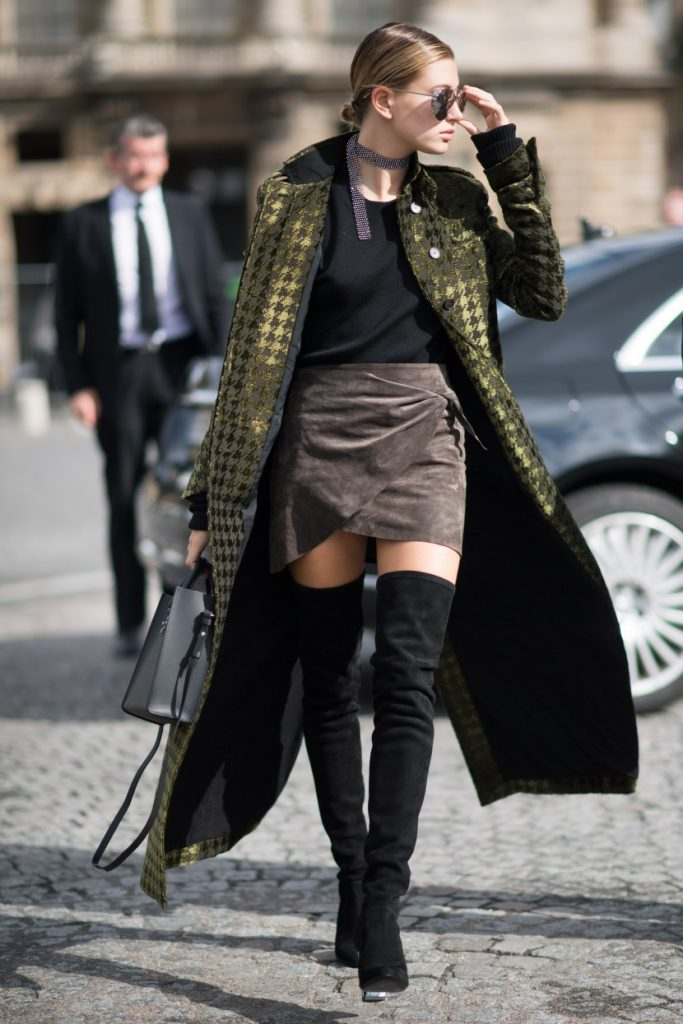 PARIS, FRANCE - OCTOBER 01: Hailey Baldwin is wearing Haider Ackerman jacket, YProject shirt, Bec and Bridge skirt and boots from Dior seen before teh Elie Saab show in the streets of Paris on October 1, 2016 in Paris, France. (Photo by Timur Emek/Getty Images)